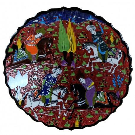 Plat artisanal rouge Avla 30cm, décor ottoman représentant une chasse