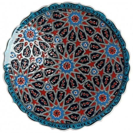 Plat ethnique Melis Rouge et Bleu 30cm à bords chantournés et motifs géométriques orientaux