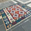 Tapis ethnique carré K06